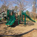 A playground for the little ones to play on. - Chicot State Park Campground + Cabins