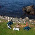 A view from the top of the lighthouse shows the picnic area at the edge of the rocky coast.- Little River Lighthouse