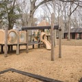 A playground and covered picnic area in the center of the state park. - Lake Bruin State Park