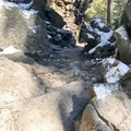 Follow the trail down, keeping the water on your left. During winter, the rocks can be slippery, so proceed with caution. - Swallow Falls State Park