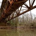 Passing under the rusty old bridge.- Bayou Jean de Jean