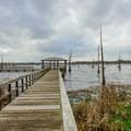 Observation deck and boardwalk over the lake.- Black Bayou Lake Canoe Trail
