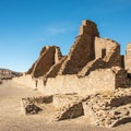 View of the Pueblo Bonito ruins from the trailhead.- Pueblo Bonito