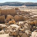 View of Pueblo Bonito from an overlook.- Pueblo Bonito