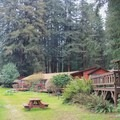 Riverside cabins and lawn area.- Fern River Resort