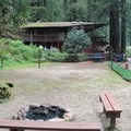 The fire pit and volleyball court.- Fern River Resort