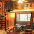 "Cabin 14, ""The Presidential,"" sleeps up to eight people and comes with a cozy sleeping loft.- Fern River Resort"