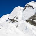The summit cone requires climbing steep snow.- Needle Peak
