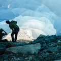 Enjoying the cool colors and features of an ice cave.- Mount Weart