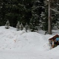 Illicilwaet Parking lot, the launching point for the trip to the hut. The skin track starts immediately to the looker's left of the little kiosk. As you ascend, watch for skiers that may be descending with their heels unlocked.- A.O. Wheeler Hut
