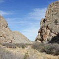 Looking toward the exit of Dog Canyon, which cuts through the Santiago Mountains.- Dog Canyon