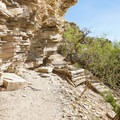 These overhanging bluffs have preserved traces of former inhabitants.- Hot Springs Historic Site