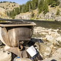 The tub is well set up with a drain valve and a bucket for cooling the water with river water.- Boat Box Hot Spring