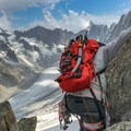 Climber on the east ridge looking over Argentiere Glacier.- Grands Montets: East Ridge