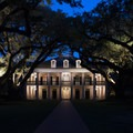 "At dusk, the lighted plantation ""Big House"" and oaks are exceptionally beautiful.- Oak Alley Plantation"