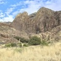 Dripping Springs is at the base of the mountains in the center. - Dripping Springs Trail