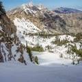 Skiing down the Eastern Twin Couloir.- Deseret Peak: Temple + Twin Couloirs