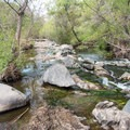 The trail crosses over the San Diego River.- South Fortuna Mountain
