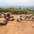These stones at the summit of Viejas Mountain once stood as a winter solstice marker constructed by Native Americans who lived in the area. In the 1970s, campers destroyed the site to construct windbreaks.- Viejas Mountain