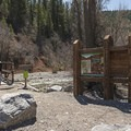 The actual trailhead is a short ways east of the lake along a dirt road. - Tibble Fork Loop