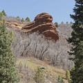 A red-rock style formation popping out of the landscape. - Tibble Fork Loop