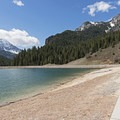 A walkway follows the shore of the lake.- Tibble Fork Reservoir