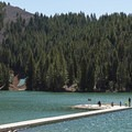 A fishing dock sits in the center of the reservoir. - Tibble Fork Reservoir