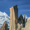 Iconic tower on the route with Mont Blanc in the background.- Arête des Cosmiques