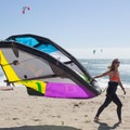 Local kiter Jenny Campbell gearing up for a kite session.- Waddell Beach Kitesurfing