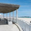 Shaded benches along the beach at Hampton Beach State Park. - Hampton Beach State Park