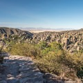 The trail gently descends from Massai Point.- Massai Nature Trail