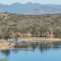 View of the boat dock at Lake Poway.- Lake Poway Trail