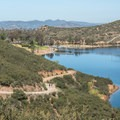 View of the trail as it loops around the lake.- Lake Poway Trail