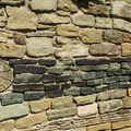 Wall segment showing the distinctive green band found at this site.- Aztec Ruins National Monument