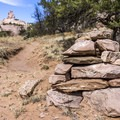 Rock cairns mark the trail.- Church Rock Trail