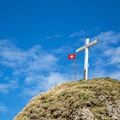 The cross and flag at the summit of Federispitz.- Federispitz