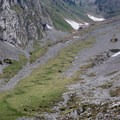 The steep, switchbacking trail up the Bockmattlipass can be seen from a distance.- Bockmattlistock