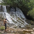 This waterfall rages after rainstorms. The flows in this photograph are relatively light. - Ho'opi'i Falls Trail