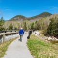 A scenic view can be seen from this walkway at the trailhead. - Lincoln Woods Trail