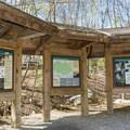 Trail information near the suspension bridge. - Lincoln Woods Trail