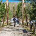 The Lincoln Woods hike starts by crossing a 160-foot long suspension bridge. - Lincoln Woods Trail