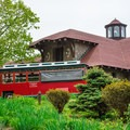 The trolley takes visitors up to the Lucknow Mansion for self-guided tours. - Castle in the Clouds