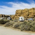 Gallo Campground is surrounded by low cliffs.- Gallo Campground