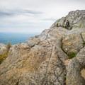 Hiking and scrambling on the rocks. - Mount Chocorua via Champney Brook Trail