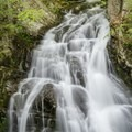 Waterfall along a hiking trail at Castle in the Clouds. - Castle in the Clouds