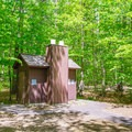 Vault restrooms.- Covered Bridge Campground