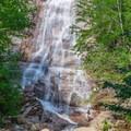 Hiker below Arethusa Falls. - Crawford Notch State Park