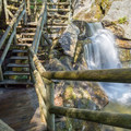 Steps leading to the top of Paradise Falls.- Lost River Gorge + Boulder Caves