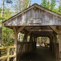 Covered bridge along a nature trail.- Lost River Gorge + Boulder Caves
