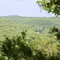 View looking out over the rolling Ozark Mountains.- River View Trail